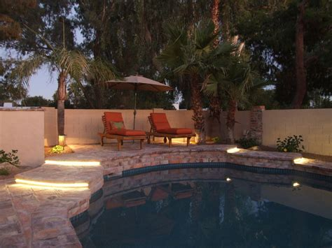pool deck lighting ideas raised deck with led ribbon lighting at steps