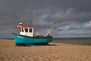 Image of small fishing boat that waits for high tide
