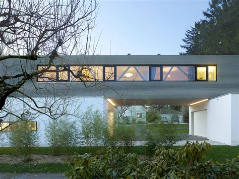 Open Kitchen Living Room Floor Plans cantilevered tannay bridge house in switzerland makes the