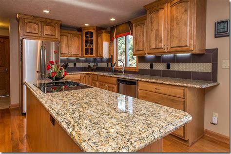 oak kitchen cabinets key features oak light river giallo ornamental granite countertops pictures cost
