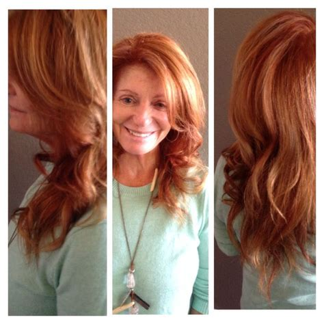 natural red lowlights with blonde highlights soft red with strawberry blonde highlight this hand