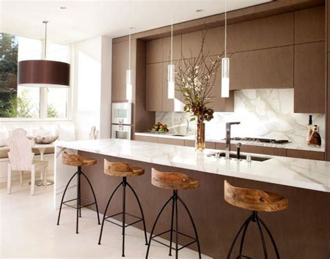 Modern Kitchen Island Lighting Glass Countertop And Pendant Lights With Metallic Tinge For A Stylish Contemporary Kitchen Decoist