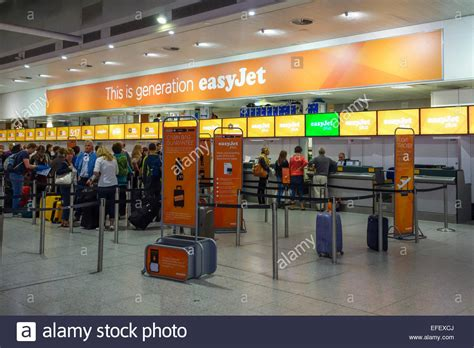 easyjet check inn easyjet check in desk at gatwick airport stock