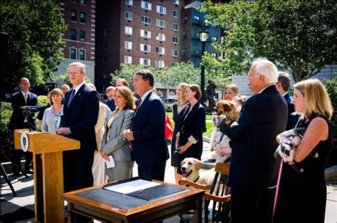 dog house new bedford montigny s anti cruelty bill signed by governor at state house ceremony new