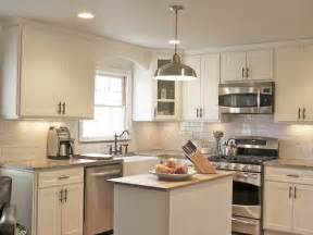 Cottage Style Kitchen Island by White Cottage Kitchen With Stainless Steel Appliances Hgtv