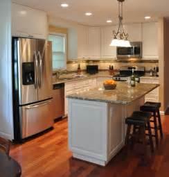 Kitchen remodel white cabinets tile backsplash undercabinet