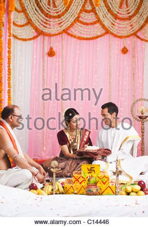 Wedding Ceremony Giving Of The by Bridegroom Giving A Sari To The At The South Indian
