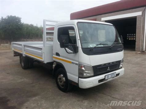 mitsubishi trucks mitsubishi fuso fe7 136 flatbed dropside trucks year of
