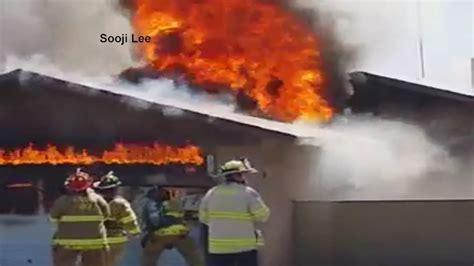 anaheim firefighter falls through roof california firefighter falls through roof of burning home