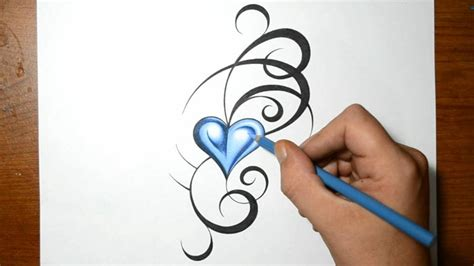blue heart tattoo designing a tribal design with a blue