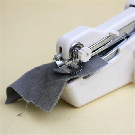 Mesin Jahit Mini Portable 202 Quality portable handy stitch handheld sewing machine white