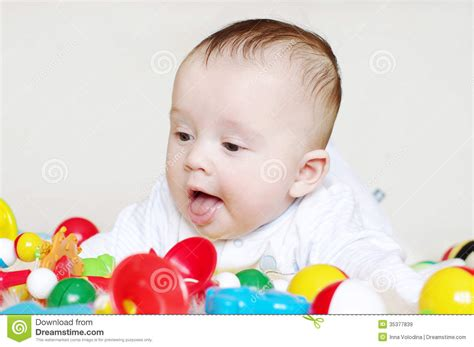 baby 4 months royalty free happy four months baby with toys royalty free stock images image 35377839