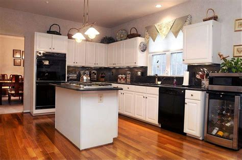 white kitchens with black appliances kitchen with white cabinets and black appliances google