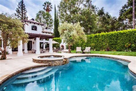 spanish colonial home  backyard pool  hot tub hgtv