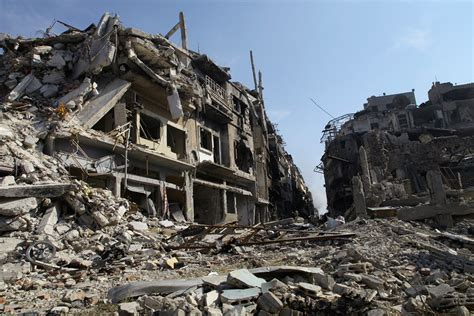 1000 images about famous demolished buildings on syria residents of homs return to city of rubble