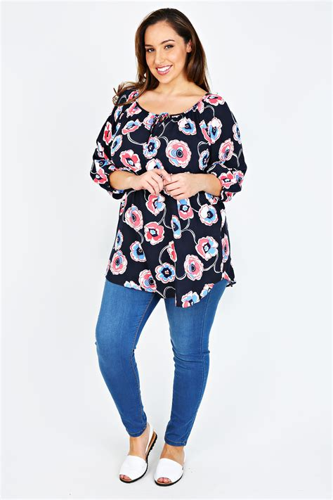 The B Club Print Blouse Blue navy blue floral print blouse with keyhole detail