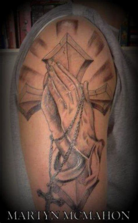 shoulder praying hands religious tattoo by otzi tattoos