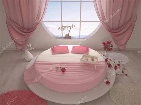 camere da letto con letto rotondo da letto con un letto rotondo e una finestra foto