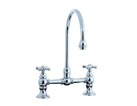 bridge style kitchen faucets cifial two handle bridge kitchen faucet remodelista