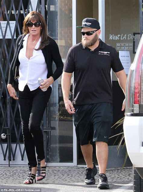 west la dogs ve caitlyn jenner wears plunging top to spend quality time with eldest burt
