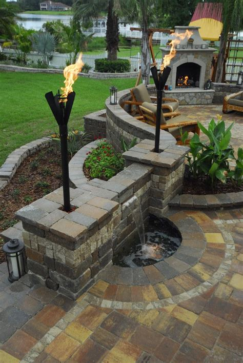 beautiful back patio water feature fireplace