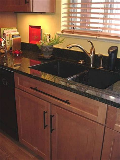 composite kitchen cabinets maple cabinets with ubatuba granite brushed brass faucet