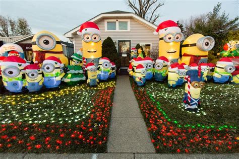 minion outdoor christmas decor minion display goes viral here s why the new albany homeowner did it news