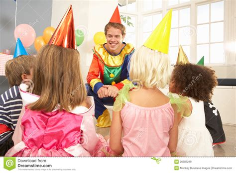 how to entertain clown entertaining children at party royalty free stock