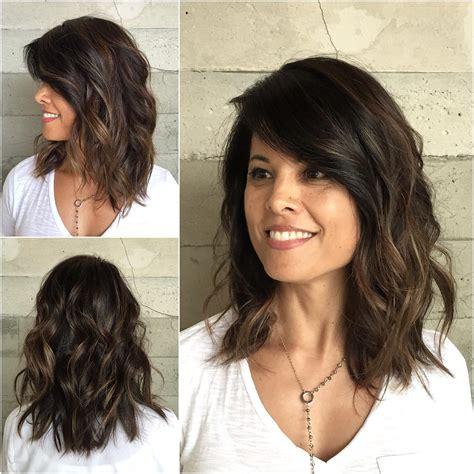 latest medium wavy hair styles  women shoulder