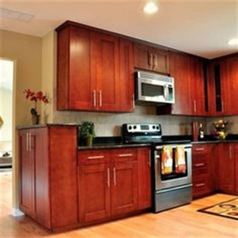 Cherry Red Kitchen Cabinets by Porcelain Tile Plank Floors With Cherry Cabinets Been