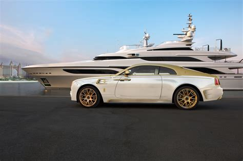 rolls royce gold and white mansory works their magic on a rolls royce wraith