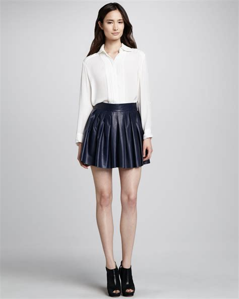 pleated leather skirt in blue navy