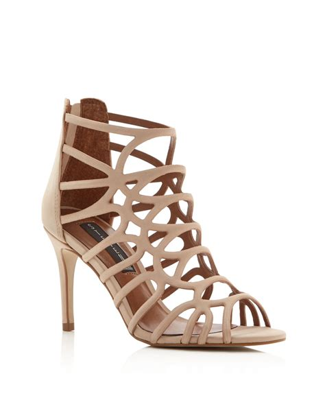 cage high heel sandals lyst steven by steve madden tana caged high heel sandals