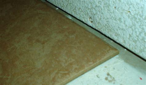 1 Drywall Floor Gap - floor tile and wall gap need filling tiling ceramics