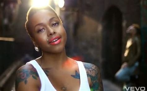 chrisette michele afro twa and colored tattoos on african