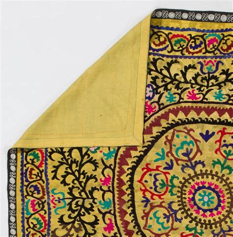 uzbek suzani embroidered textile used as throw wall hanging or vintage yellow uzbek embroidered wall hanging or bed cover