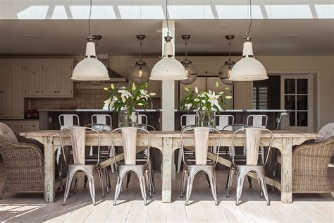 Industrial Style Dining Room Lighting Charming Dining Room With Industrial Lighting And A Cool Indoor Outdoor Interplay Design