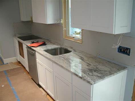 How To Decorate A Craftsman Home by Thunder White Granite Kitchen Beach Style With Oven Hood