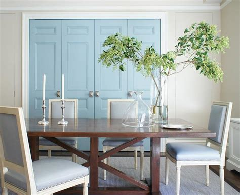 blue dining room boasts a trestle dining table surrounded