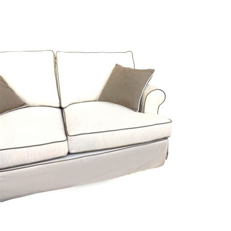 linen two seat sofa with contrast piping in beige