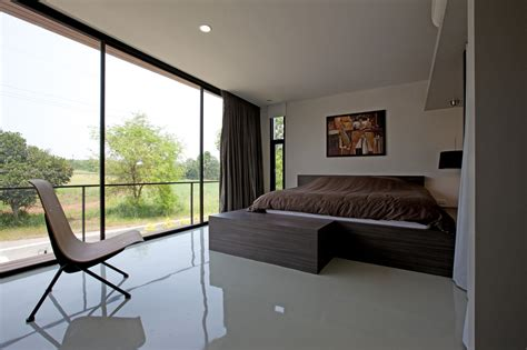 30 floor to ceiling windows flooding interiors with