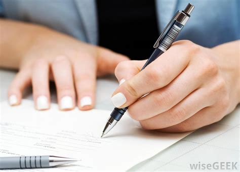 person writing on paper should still use cursive writing with pictures