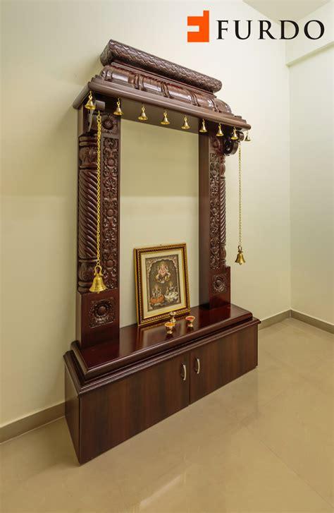 traditional carved wooden puja mandir hindu home temple  brassbells  cabinets  furdo