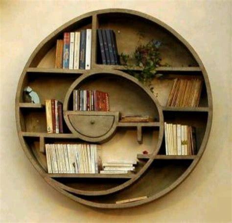 bookshelf round like a hobbit door or a portal
