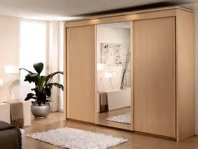 Home Decor Sliding Wardrobe Doors wooden cupboard design inspiration with three sliding wardrobe doors