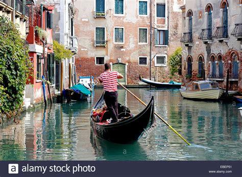 gondola and boat venice italy dorsoduro gondola gondolier with cell phone