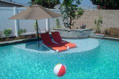 tanning in the backyard swimming pool sun shelf swimming pool thermal ledges