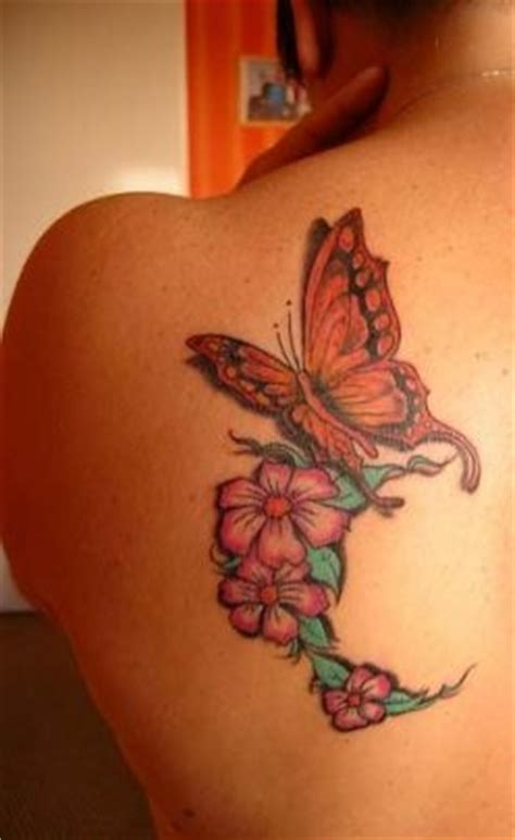 Elegant Butterfly Tattoos Enhanced With Flower Designs Butterfly Tattoos On Shoulder Blade