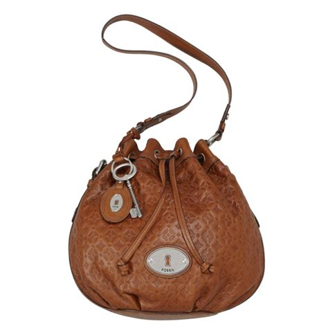 fossil maddox embossed drawstring in brown lyst
