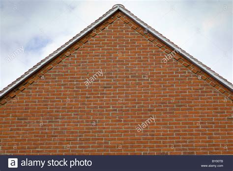 ending of house the gable end of a house roof showing brick decorative detail stock photo royalty